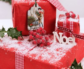 xm_traditional_presents - Christmas presents wrapped in red paper with holly and snow
